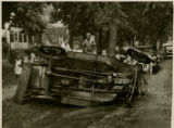 Wrecked car at side of street, children posing nearby, early 20th century, Morristown, NJ