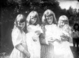 Outdoor portraits of four young girls with dolls, ca. 1900, Morris County, NJ