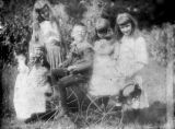 Glass plate negatives, outdoor portraits of children, group with tricycle, circa 1900, Morris...