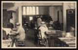 Morristown & Morris Township Public Library interior, 1 Miller Road, patrons at tables, 1918,...