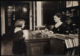 Morristown & Morris Township Public Library interior, librarian and young patron, 1917,...