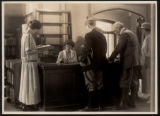 Morristown & Morris Township Public Library interior, librarians and patrons, early 20th...