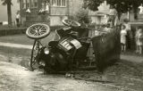 Wrecked car at side of street, children in background, circa 1900, Morristown, NJ