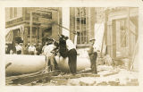 National Iron Bank, construction accident with closeup of fallen pillar and broken wooden hoist,...