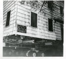 Estey house, closeup of house on flatbed truck, moving from Spring street to Speedwell Village, ...