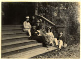 Young men and women posed on stairs, circa 1880