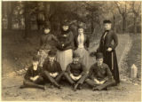Young men and women, posing on drive, circa 1880
