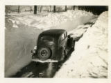 Car driving through recently ploughed road, 02/14/40 Chester, NJ