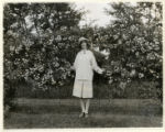 Pauline Brennan of Olyphant Place, Morristown, with rose-covered fence,  08/02/1927, Basking...