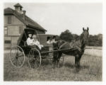 Mrs. Wortman and her horse and carriage at the race course on South Street, 06/27/1908, Morris...