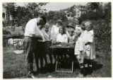 Mr. W. F. Knowles and children judging vegetables, 07/29/1919, Mountain Lakes, NJ