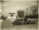 World War I Memorial Marker, flowers at base, Vail Mansion in background, 11/12/1928