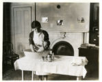 Miss Ketch, a visiting nurse bathes a baby, 09/17/29, Morristown, NJ