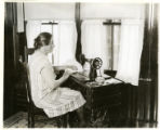 Mrs. Pierson at sewing machine, Clinton Street, 09/17/29, Morristown, NJ