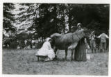 Woman milking a cow at pageant, 07/05/26, Chatham, NJ