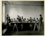 Salvation Army, basement, worker's children, stringing beads, 6/10/1924, Morristown, NJ