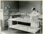 Memorial Hospital Nursery, babies in baskets, nurse and baby, 7/15/1924, Morristown, NJ