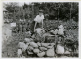 Albert Sickler and stone rock garden, 8/7/1919, Rockaway, NJ