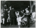 Baby parade, woman with trophy cup and reaching child, 10/12/1914, Summit, NJ