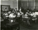 Miss Margaret Mulholland, class and nurse Miss Holly at the George Washington school, 12/9/31,...