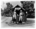 Chamber of Commerce information booth with Jas. D. Ball Jr. (L) & Harry Adams (R), 07/09/1932,...